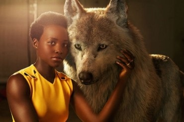 "Scarlett Johansson, Lupita Nyongo and Idris Elba on the promotional photo of ""the jungle Book"""