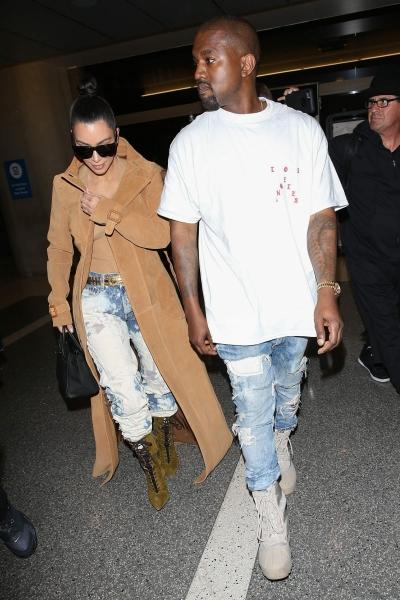 Ким Кардашьян с Канье Уэстом приехали в аэропорт Лос Анжелеса