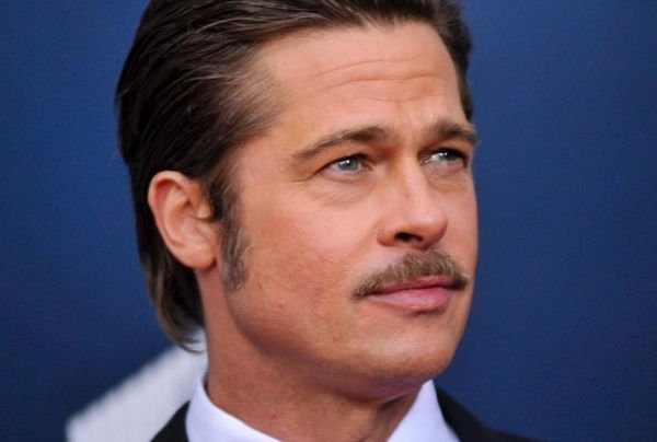 Брэд Питт начал оказывать знаки внимания другой женщине еще во время развода с Анджелиной Джоли