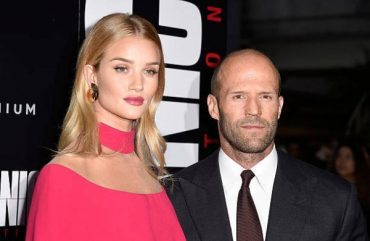 A family holiday: Rosie Huntington-Whiteley and Jason Statham's son in London