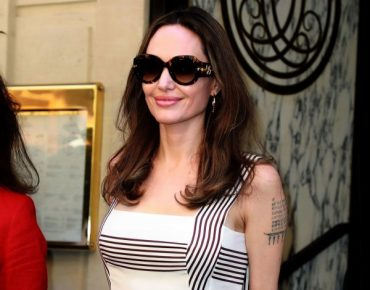 Images of Angelina Jolie in Paris, from lace to shirts to stylish dresses