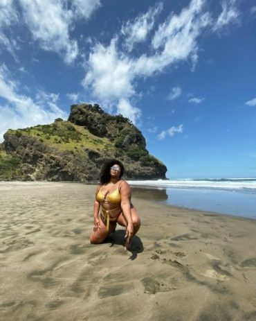 American singer Lizzo in a Golden swimsuit on a photo shoot on new Zealand beach